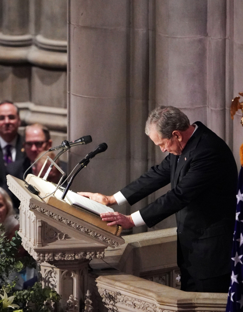 Former US president George W. Bush pauses as he delivers an eulogy during a funeral service for his father former US president George H. W. Bush at the National Cathedral in Washington, DC on December 5, 2018. (Photo by MANDEL NGAN / AFP)