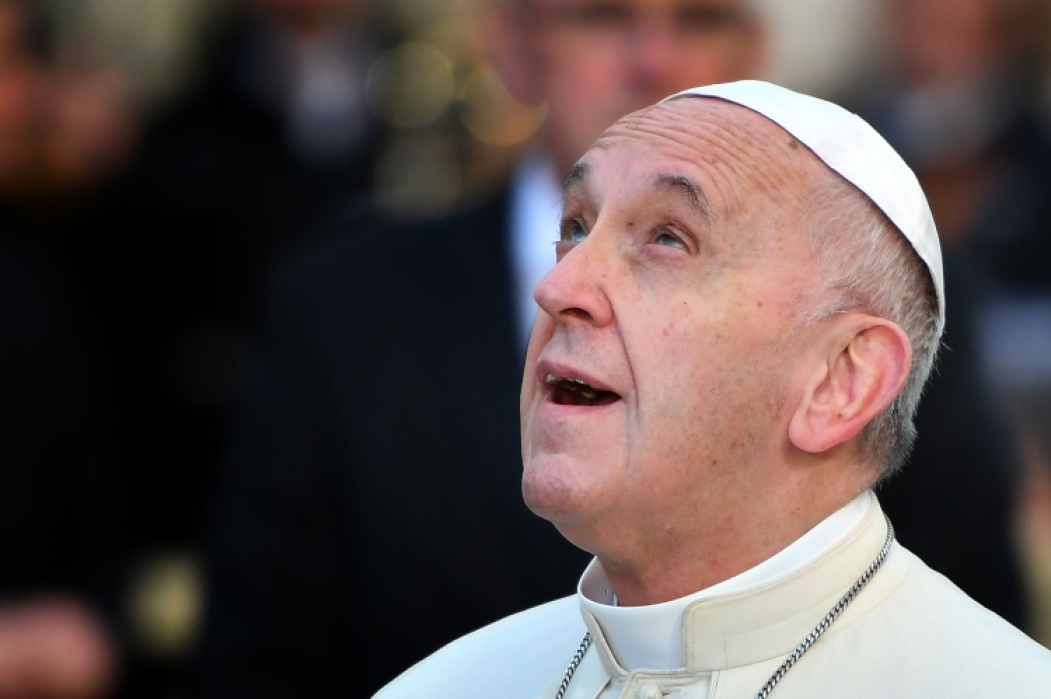 Pope Francis looks up during the annual feast of the Immaculate Conception at Piazza di Spagna in Rome on December 8, 2018. (Photo by Alberto PIZZOLI / AFP)       Caption