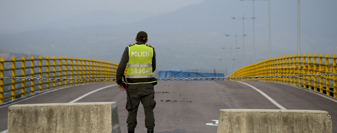 Colombian police stand nex to a stage for a concert organized by British billionaire Richard Branson to raise money for the Venezuelan relief effort in Cucuta, Colombia, on February 21, 2019 at the Tienditas International Bridge which has been blocked with containers by loyalists of Venezuelan President Maduro to prevent access to the country. - Branson is organizing a big concert to raise 100 million dollars in humanitarian aid for Venezuela and pressure the government to let the aid into the country. (Photo by Raul ARBOLEDA / AFP)