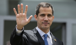 Venezuelan opposition leader and self-declared acting president Juan Guaido, waves after holding a meeting at the European Union headquarters in Brasilia on February 28, 2019. - Venezuela's opposition leader Juan Guaido arrived early Thursday in Brazil for talks aimed at securing more support from President Jair Bolsonaro, press reports said. There are fears he might be arrested upon his return to Venezuela. (Photo by Sergio LIMA / AFP)