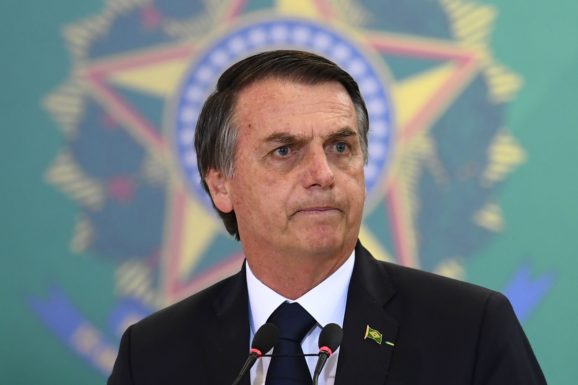 (FILES) In this file photo taken on January 07, 2019 Brazilian President Jair Bolsonaro delivers a speech during the appointment ceremony of the new heads of public banks, at Planalto Palace in Brasilia on January 7, 2019. - US President Donald Trump will host his Brazilian counterpart Jair Bolsonaro on March 19, the White House said March 8, 2019, the first meeting between the two rightwing leaders who have lavished praise on each other. The visit was announced by Brazil's foreign ministry last month but a firm date had not been finalized. (Photo by EVARISTO SA / AFP)