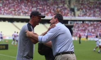 Apesar de suas equipes serem adversárias, treinadores mantém boa relação.