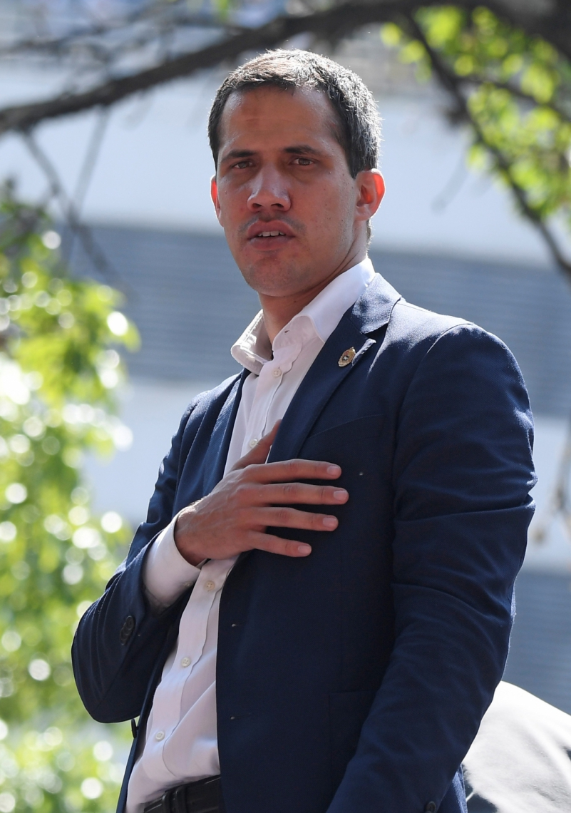 Venezuelan opposition leader and self-proclaimed acting president Juan Guaido gestures during a gathering with supporters after members of the Bolivarian National Guard joined his campaign to oust President Nicolas Maduro and clashed with soldiers loyals to the government, in Caracas on April 30, 2019. - Guaido said there is 'no turning back' in the bid to oust Maduro. (Photo by Federico PARRA / AFP)