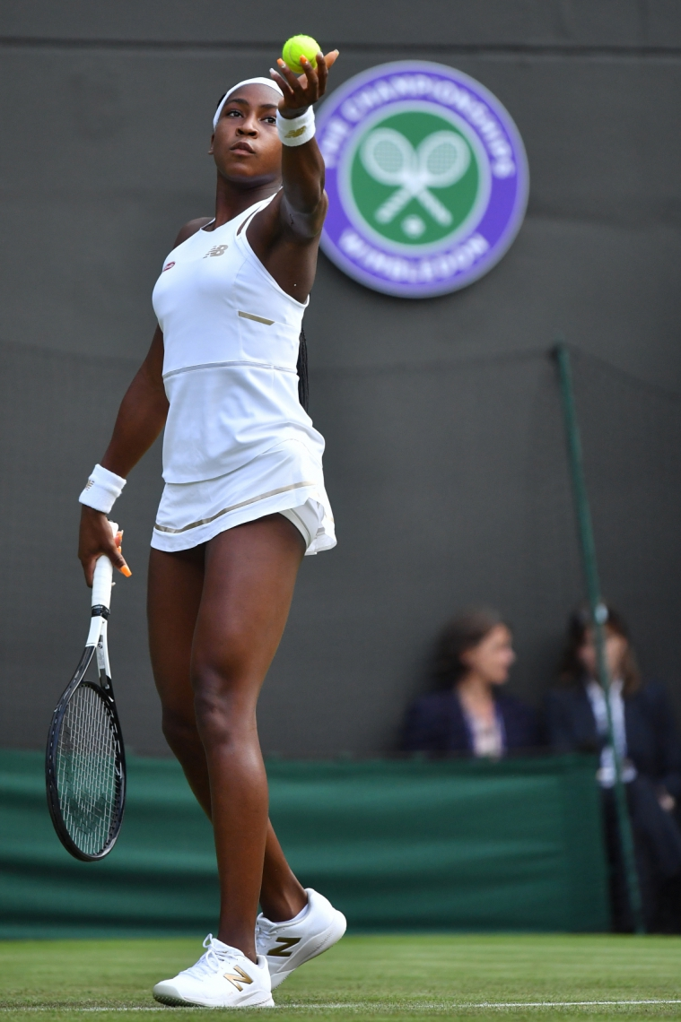 US player Cori Gauff prepares to serve to US player Venus Williams during their women's singles first round match on the first day of the 2019 Wimbledon Championships at The All England Lawn Tennis Club in Wimbledon, southwest London, on July 1, 2019. (Photo by Ben STANSALL / AFP) / RESTRICTED TO EDITORIAL USE