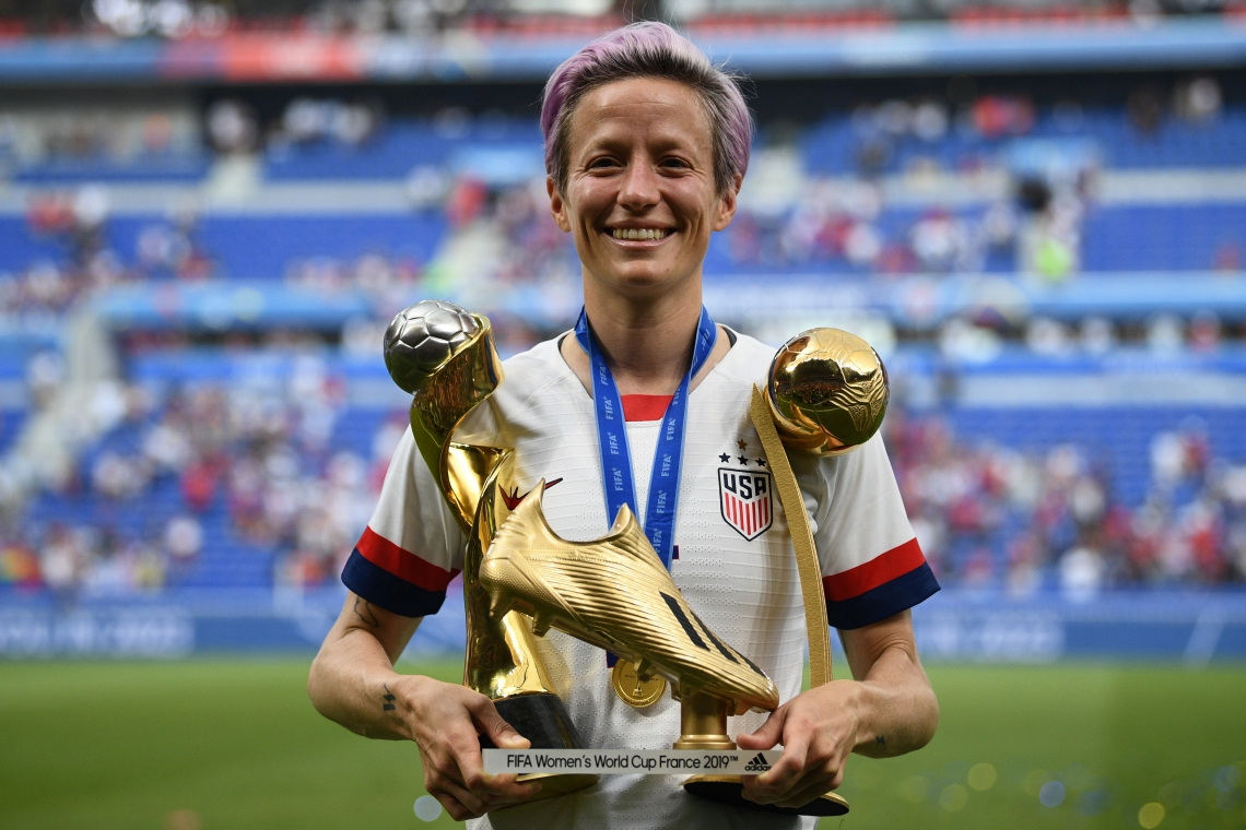 United States' forward Megan Rapinoe poses with the trophies after the France 2019 Women's World Cup football final match between USA and the Netherlands, on July 7, 2019, at the Lyon Stadium in Lyon, central-eastern France. (Photo by FRANCK FIFE / AFP)