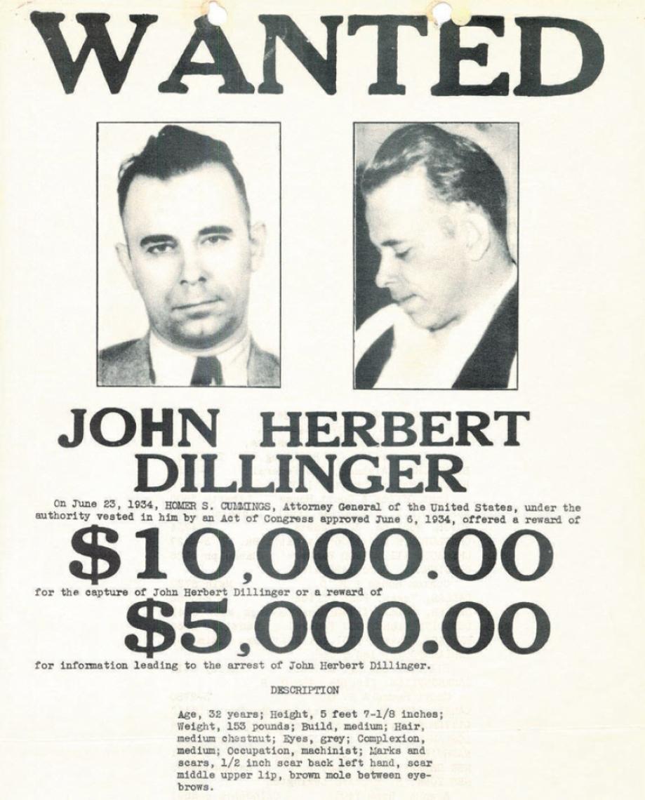 Cartaz com oferta de recompensa pelo gangster