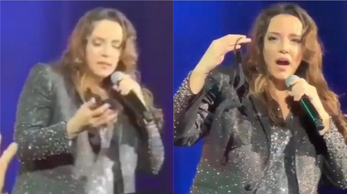 Fã de Ana Carolina surpreende cantora ao jogar calcinha no palco durante show.