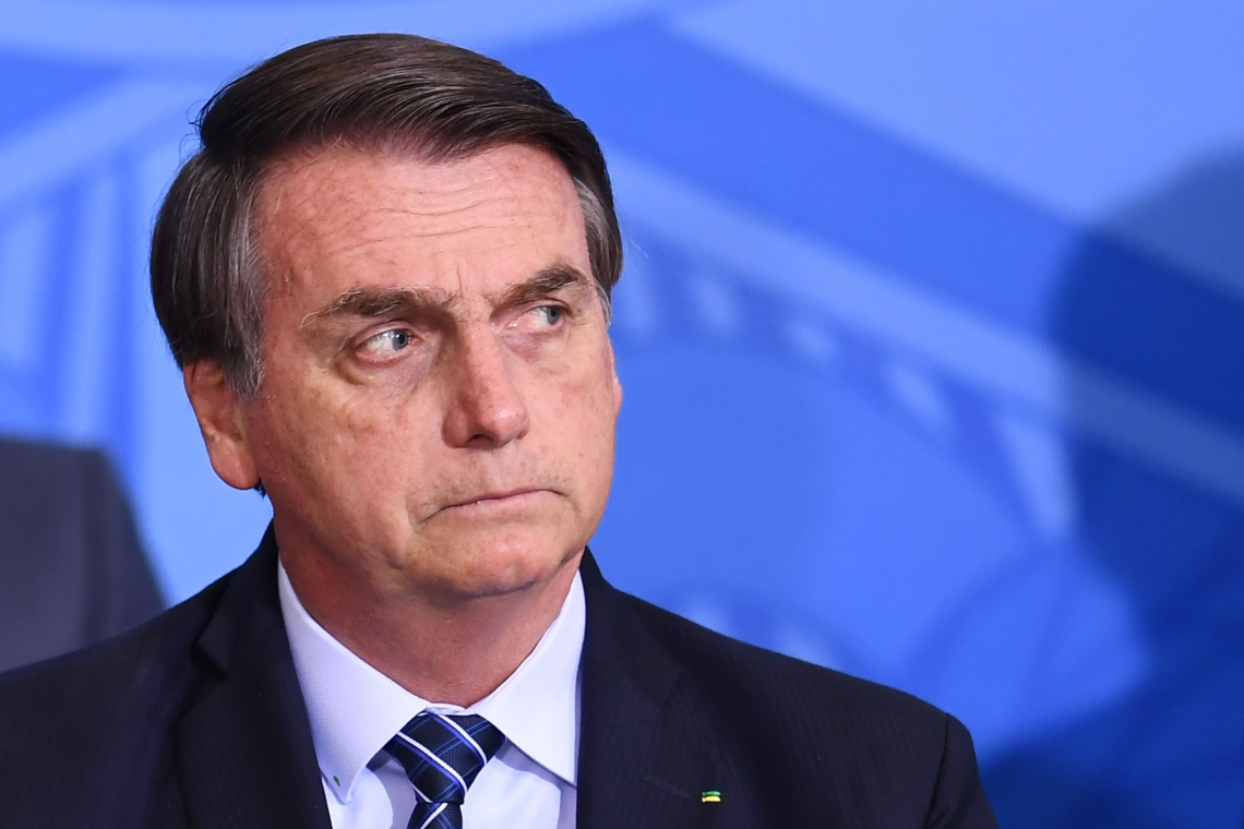 Brazilian President Jair Bolsonaro looks on during the launching ceremony of the Front Brazil Project, which aims at reducing the rates of violence in cities, at Planalto Palace in Brasilia, on August 29, 2019. (Photo by EVARISTO SA / AFP)       Caption