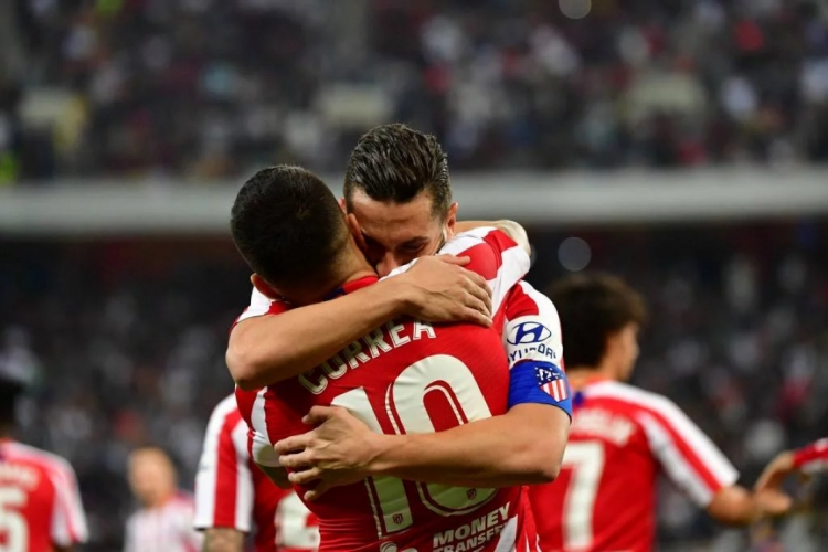 Koke e Correa marcaram gols na partida  (Foto: Giuseppe Cacace/AFP)