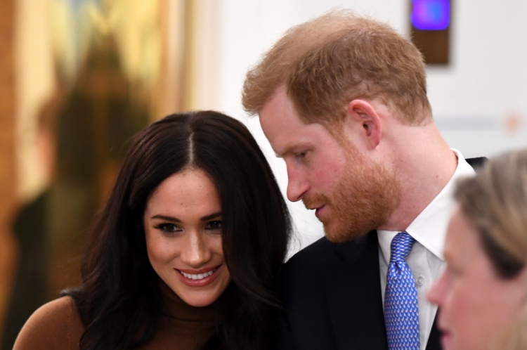 Principe Harry e a duquesa Sussex (Photo by DANIEL LEAL-OLIVAS / POOL / AFP)