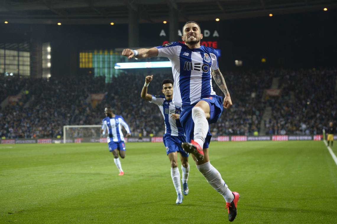 FC Porto's Brazilian defender Alex Telles celebrates after scoring a goal during the Portuguese league football match between FC Porto and Portimonense SC at the Dragao stadium in Porto on February 23, 2020. (Photo by MIGUEL RIOPA / AFP)