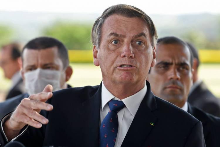 Jair Bolsonaro, presidente da República, na entrada do Palácio da Alvorada, em Brasília (Foto: Evaristo Sá / AFP)
