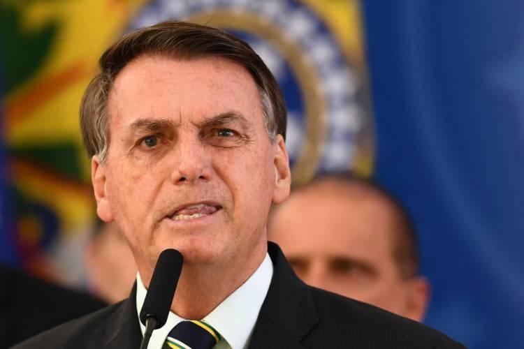 Bolsonaro é um dos únicos líderes do planeta a se posicionar contra medidas de isolamento social (Foto: EVARISTO SA / AFP)