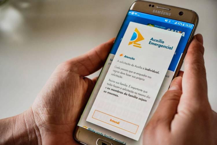 Aplicativo do auxílio emergencial da Caixa Econômica Federal (Foto: JULIO CAESAR)