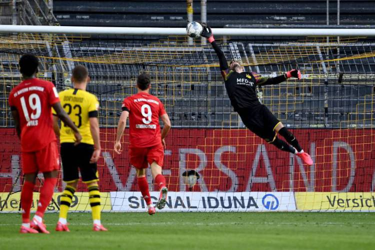 Na Alemanha, até clássico entre Borussia Dortmund e Bayern de Munique já aconteceu  (Foto: Federico GAMBARINI / POOL / AFP)
