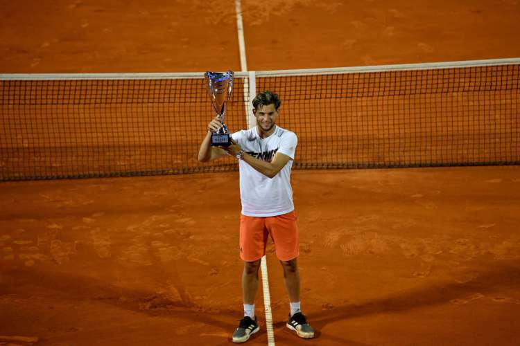 O austríaco Dominic Thiem foi o campeão do torneio organizado por Novak Djokovic (Foto: AFP)