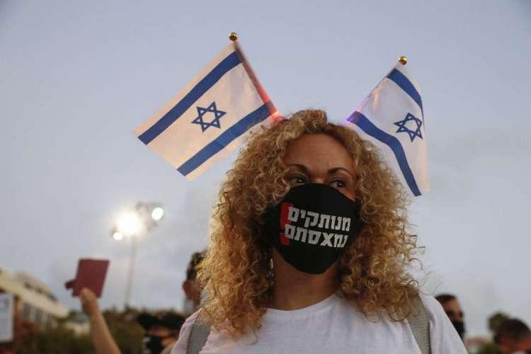 Protesto em Israel contra as ações do governo diante da pandemia de Covid-19 (Foto:  Jack GUEZ / AFP)