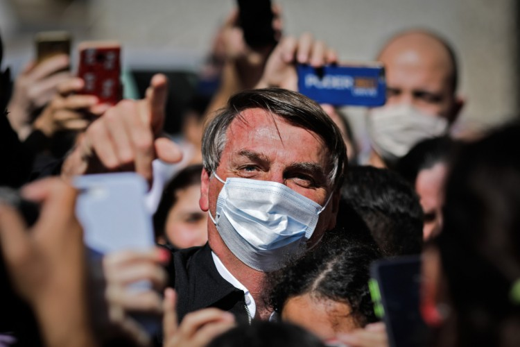 O presidente brasileiro Jair Bolsonaro ameaçou jornalista após pergunta sobre depósitos em dinheiro  (Foto: Sergio Lima / AFP)