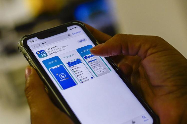 Aplicativo Caixa Tem, usado para pagamentos e compras com auxílio emergencial (Foto: Marcello Casal Jr/Agência Brasil)
