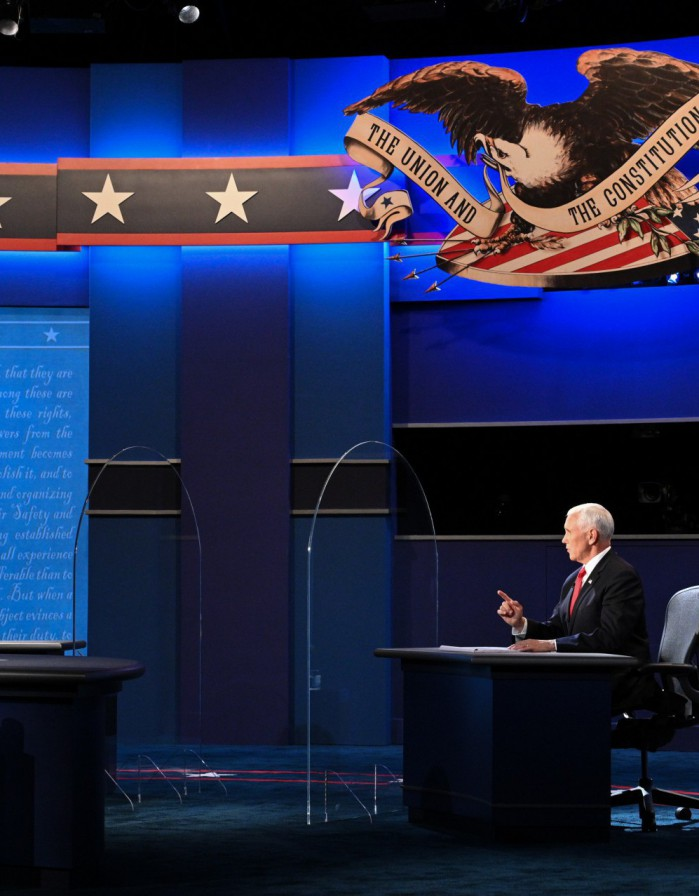 US Vice President Mike Pence Mike Pence (R) and US Democratic vice presidential nominee and Senator from California, Kamala Harris participate in the vice presidential debate in Kingsbury Hall at the University of Utah on October 7, 2020, in Salt Lake City, Utah. (Photo by Robyn Beck / AFP)