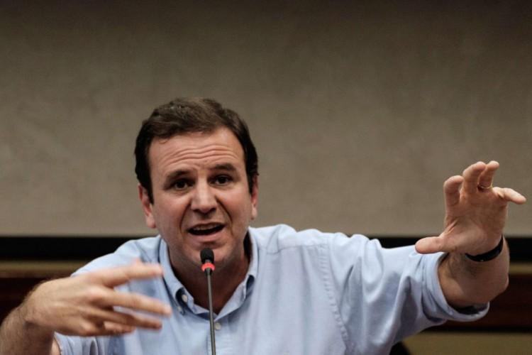 Ex-prefeito Eduardo Paes é líder isolado em todas as pesquisas divulgadas na disputa (AFP PHOTO / YASUYOSHI CHIBA) (Foto: AFP PHOTO / YASUYOSHI CHIBA)