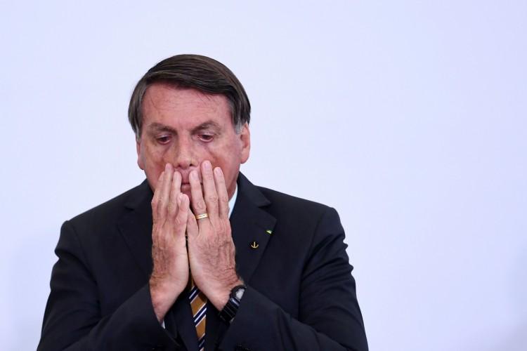 O presidente Jair Bolsonaro durante o lançamento de um programa de retomada do turismo, setor gravemente afetado pelo novo surto de coronavírus, no Palácio do Planalto, em Brasília, em 10 de novembro de 2020.  (Foto de EVARISTO SA / AFP) (Foto: EVARISTO SA / AFP)