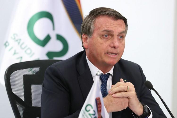 O presidente da República, Jair Bolsonaro, participa da reunião da Cúpula de Líderes do G20 em formato virtual no palácio do Planalto (Foto: Marcos Corrêa/PR)