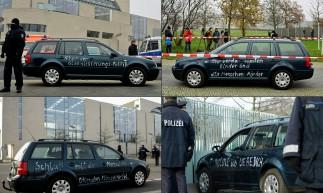 carro com o slogan 'Pare a política de globalização' pintado em suas portas depois que ele entrou no portão da Chancelaria Alemã e foi removido pela polícia, no centro de Berlim em 25 de novembro de 2020