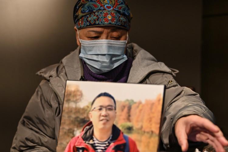 Zhong Hanneng fala sobre o filho que morreu de Covid-19 em Wuhan (Foto: AFP)