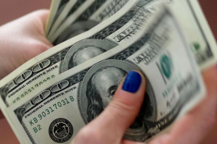 idólar, dinheiro (Foto: Reuters/Direitos reservados)