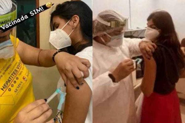 Gêmeas da família Lins, recém-formadas, recebendo a vacina contra Covid no 1º dia de campanha em Manaus. (Foto: Reprodução)