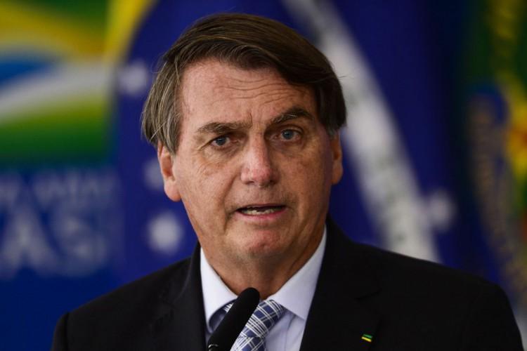 O presidente Jair Bolsonaro durante cerimônia para sanção dos projetos de lei que ampliam a aquisição de vacinas pelo Governo Federal. (Foto: Marcelo Camargo/Agência Brasil)