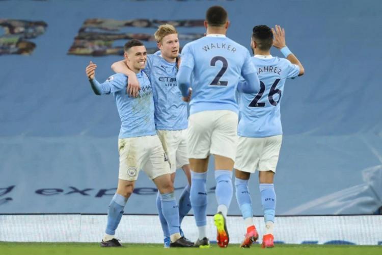 Man City precisa de seis vitórias (até o momento) para se sagrar campeão da Premier League 2020/21 (Foto: Clive Brunskill / POOL / AFP)