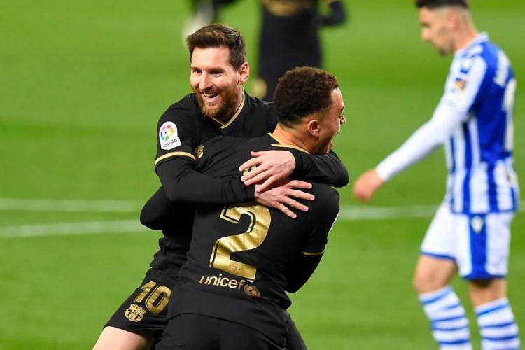 Messi se tornou o jogador com mais partidas pelo Barcelona e fez dois na goleada de 6 a 1 contra a Real Sociedad (Foto: Ander Gillenea / AFP)