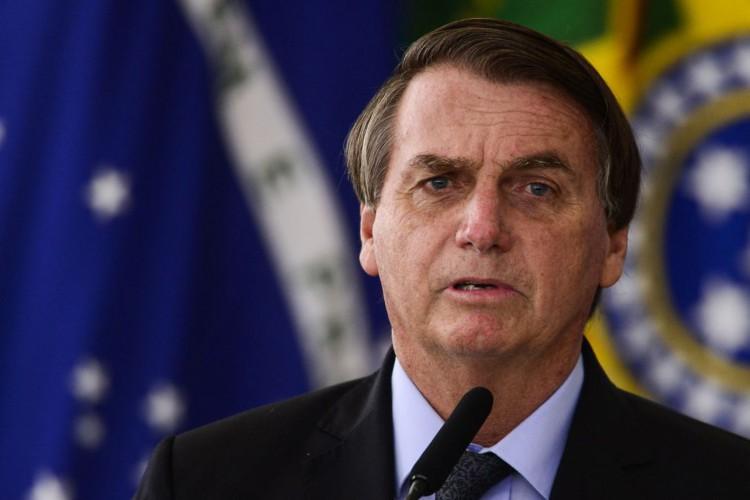 O presidente Jair Bolsonaro assina MP para melhorar ambiente de negócios no País (Foto: Marcelo Camargo/Agência Brasil)