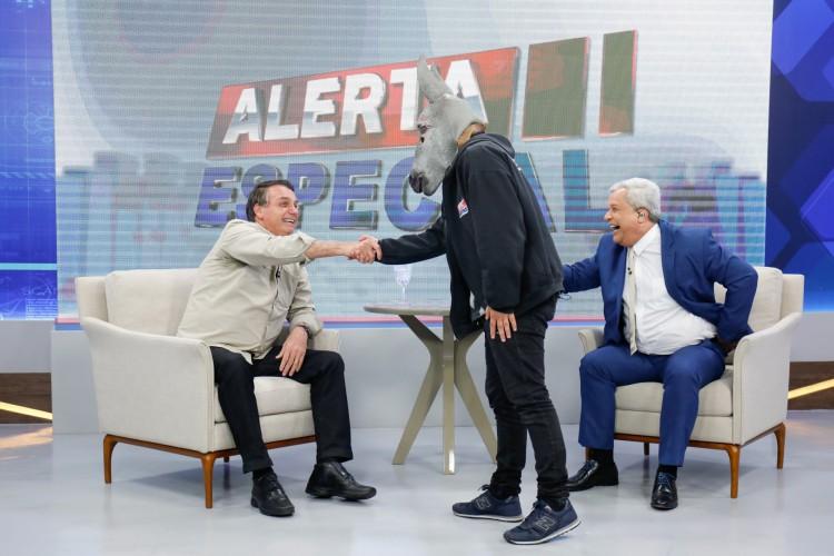 Presidente Jair Bolsonaro durante entrevista ao apresentador Sikêra Júnior (Foto: Alan Santos/PR)