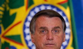 Presidente Jair Bolsonaro fala durante evento 'Ações Socioambientais e Adesão ao Programa Adote um Parque', no Palácio do Planalto, em Brasília, em 12 de maio de 2021. (Foto Sergio Lima / AFP)