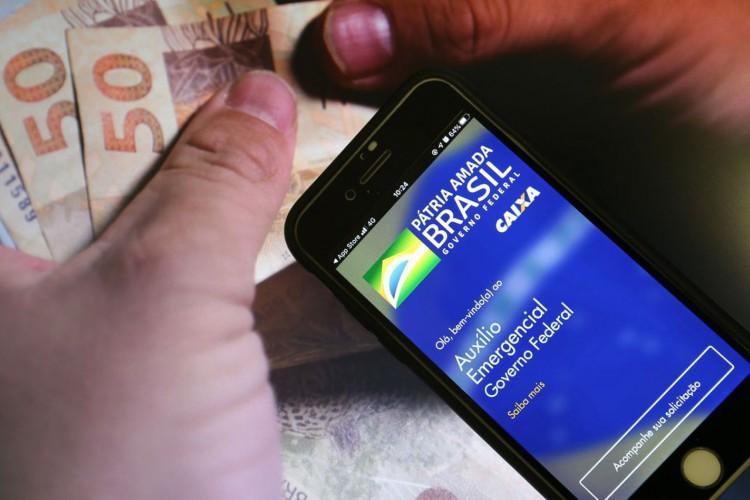 O calendário da terceira parcela do auxílio emergencial de 2021 começa nesta sexta-feira, dia 18; veja tabela com datas de pagamento e saque (Foto: Marcello Casal JrAgência Brasil)