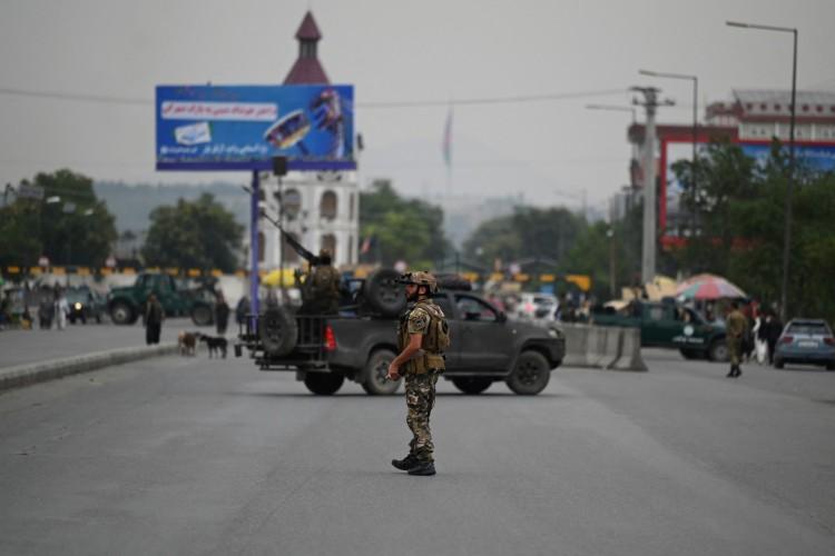 Forças de segurança nos arredores do palácio presidencial em Cabul, capitão do Afeganistão (Foto: Sajjad Hussain/AFP)