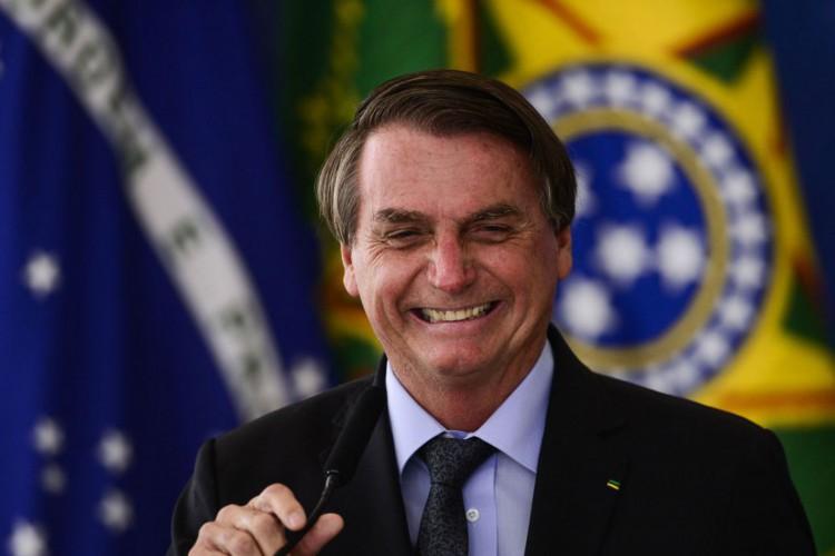 O presidente Jair Bolsonaro durante cerimônia para o  anúncio de investimentos para o Programa  (Foto: Marcelo Camargo/Agência Brasil)