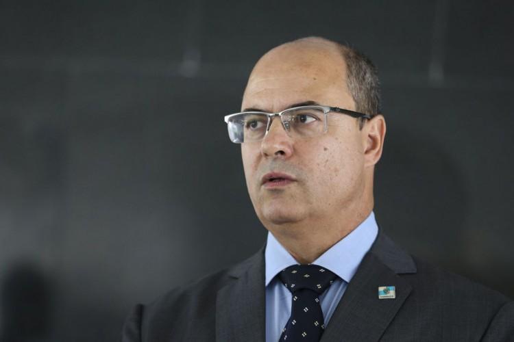 O governador do Rio de Janeiro, Wilson Witzel, fala à imprensa após reunião com o presidente da República, Jair Bolsonaro, no  Palácio do Planalto. (Foto: Antonio Cruz/Agência Brasil)