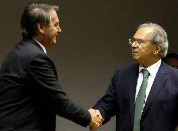 O presidente da República, Jair Bolsonaro e o ministro da economia, Paulo Guedes,fazem  declaração conjunta à imprensa no auditório do ministério da economia em Brasília
