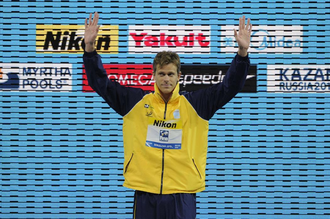 Gold medalist Brazil's Cesar Cielo Filho gestures during the award ceremony of the men's 50-metre butterfly swimming event in the FINA World Championships at Palau Sant Jordi in Barcelona on July 29, 2013.  AFP PHOTO / JOSEP LAGO