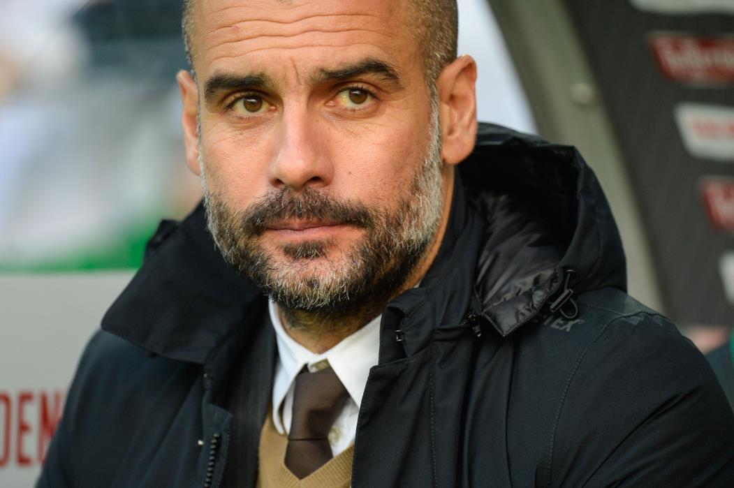 Pep Guardiola é técnico do Manchester City