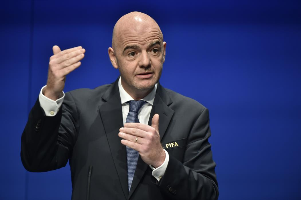 International Federation of Association Football (FIFA) President Gianni Infantino gestures while speaking during a press briefing closing a meeting of the FIFA executive council on January 10, 2017 at FIFA headquarters in Zurich.