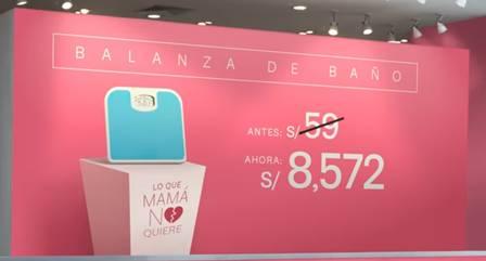 Painel de propaganda da loja em rosa, com a imagem de uma balança.